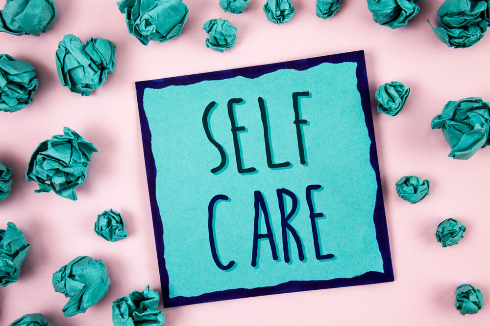 Self Care image in pink and teal