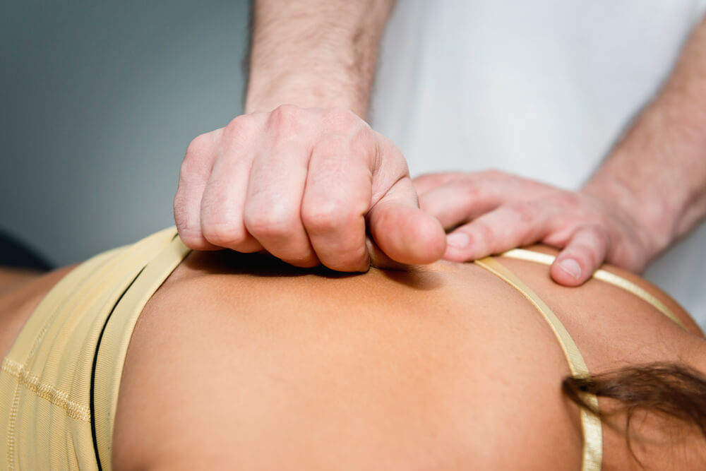 Myofascial Release - practitioner working on patient's back