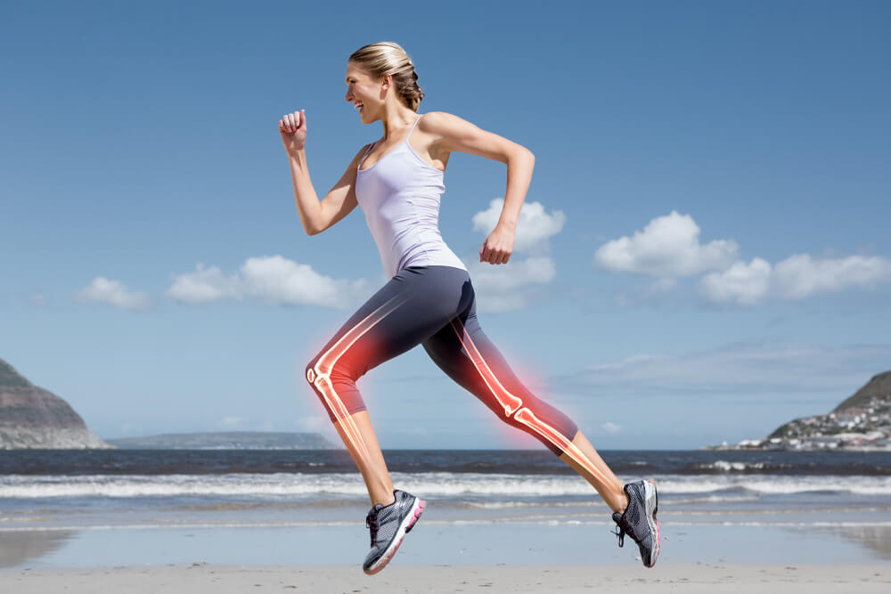 blonde woman running on the beach with her leg joints highlighted